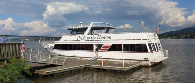 Pride of the Hudson boat docked with gangplank attached.