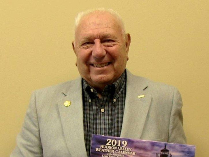 Weatherman Jim Witt holding his 2019 Long Range Forecast Calendar