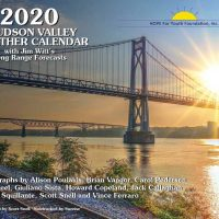 2020 Calendar Cover. Sun setting behind bridge over wide river.