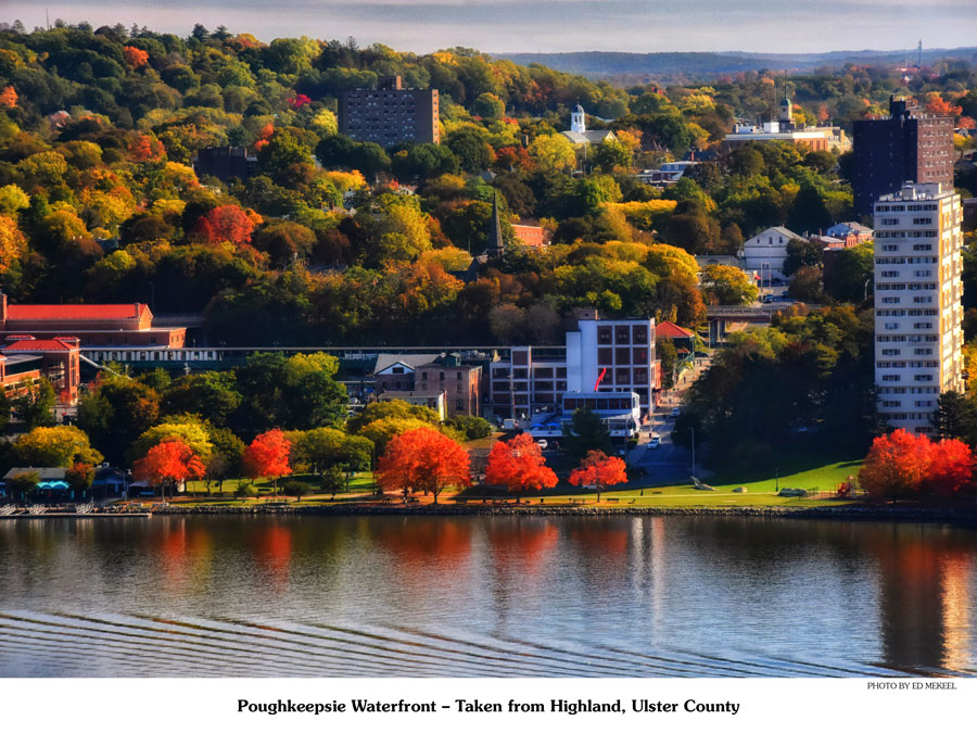 Apartment buildings and bright colored leaves on trees in autumn in the waterfront scene.